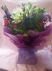 hand tied in water florists choice